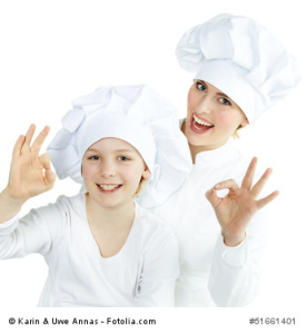 Mother and child having fun in the kitchen